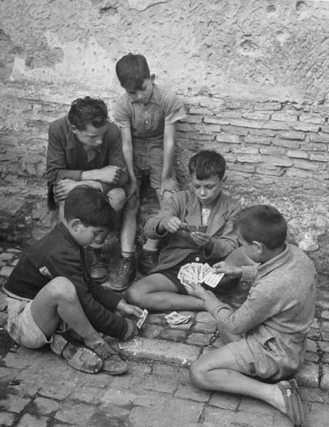 Italian Vintage Photographs ~ Boys playing cards. Photograph by Dmitri Kessel. Ariccia, Italy, June 1948. #Italy #Italian #vintage #photographs #family #history #culture