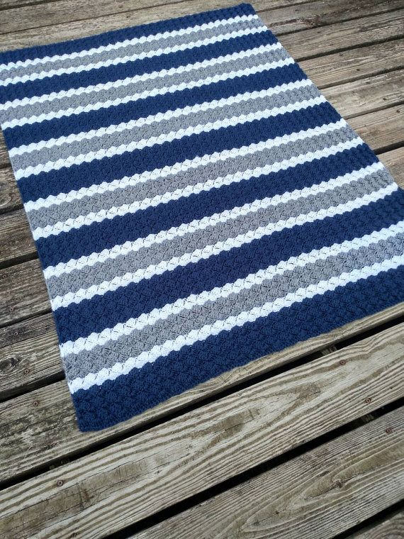 Cuddly Blue, Grey and White striped crochet Afghan! Made in Dallas Cowboys colors but I can do any team you want! Available in multiple sizes from baby blanket size to full size bed! Want a custom size or different colors? Just message me! I love special orders! I am here to create your new favorite blanket! Makes a great gift! This lovely handmade blanket is made using double crochet clusters in a light spring tones of dark navy blue, gray and white stripes. Afghan is handmade with…