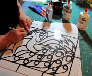 How to make faux stained glass with glue and acrylic paint.