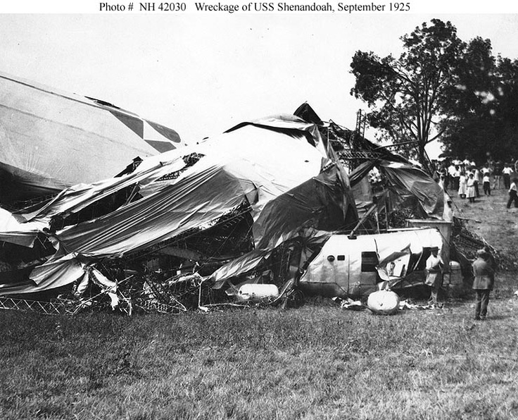Crash of USS Shenandoah (ZR-1), 3 September 1925    The wrecked airship's after section, taken soon after she crashed in southeastern Ohio.  This view shows the starboard forward part of the after section, with Shenandoah's top national star marking in left center and one of her five engine cars in the right foreground.  Photograph was received from the Office of Naval Intelligence, 7 November 1940.    U.S. Naval Historical Center Photograph