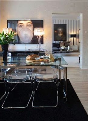 Black dining room. Kartell Bourgie lamps. Glass dining room table. Black accents. Interior design.
