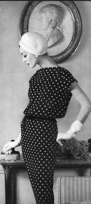 1956, Dovima in a black and white polka-dot silk crepe dress softly bloused from a natural waist by Jean Patou, photo by Henry Clarke, Vogue March