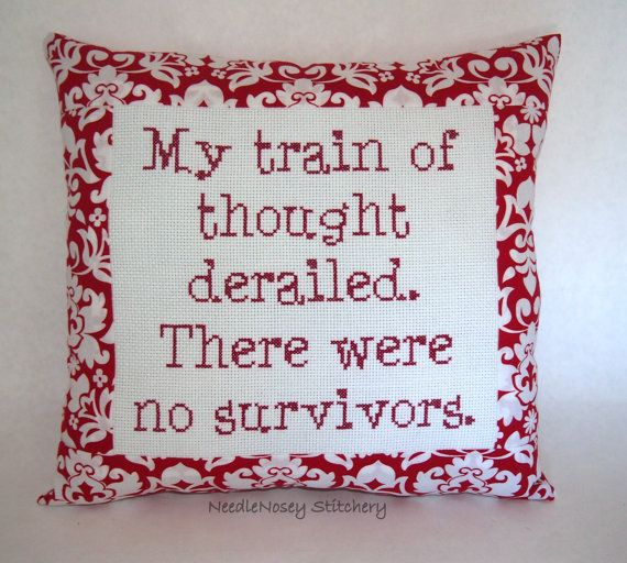 This is a little pillow done in red. It measures roughly 10 x 11 inches in size at the outside dimensions. The stitching is done on 14-count Aida