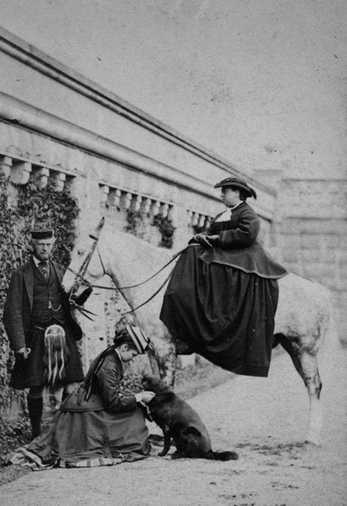 Queen Victoria with her daughter Princess Louise, Duchess of Argyll, Sharp (Queen's dog) and John Brown - c. 1868