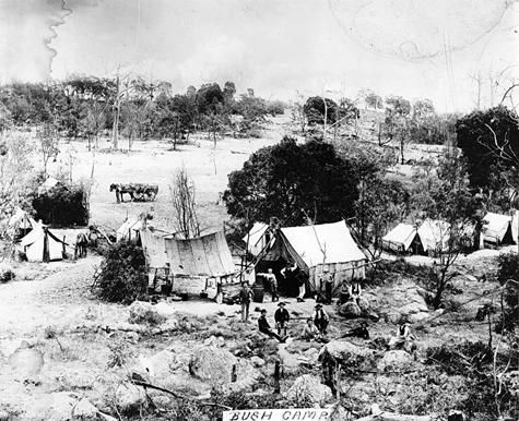 BUSH CAMP - A gold mining camp. There are miners and tents in the foreground and a horse and dray in the distance.Kyneton District, Victoria, Australia, circa 1865