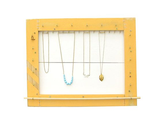 This beautifully handcrafted, eco-friendly jewelry organizer allows you to store, display, and organize your necklaces, bracelets, rings & brooches.  Hand painted & handmade from reclaimed materials