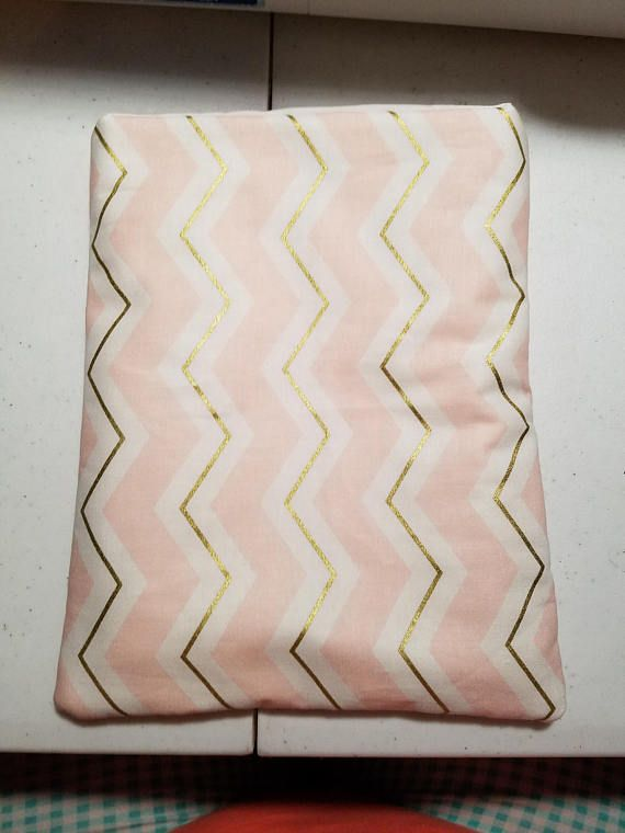 Check out this item in my Etsy shop https://www.etsy.com/listing/546093941/pink-and-gold-chevron-book-sleeve