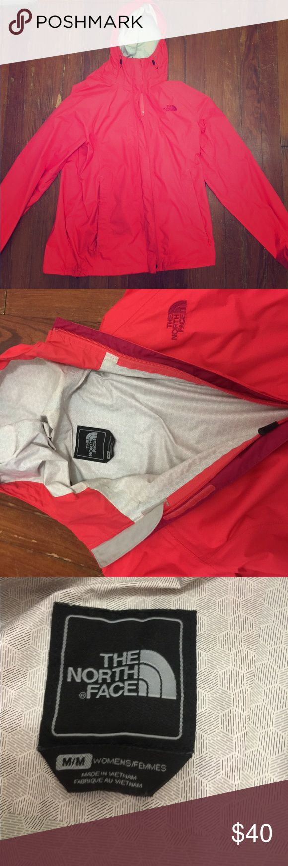 The North Face rain jacket A hot pink/bright melon color. Women's size medium. Hardly used lightweight rain jacket. I am a small but a medium allows for layering and still looks great. The North Face Jackets & Coats