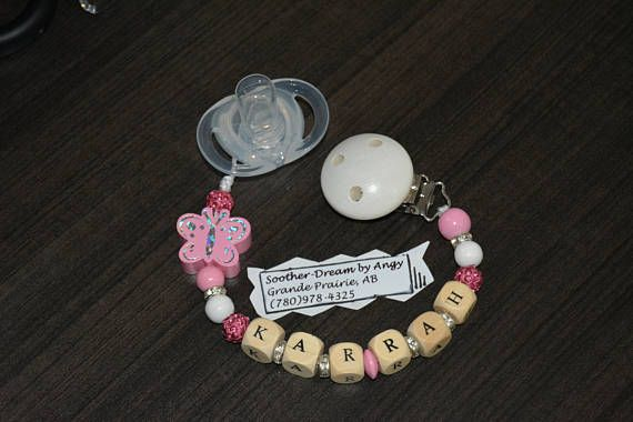 Check out this item in my Etsy shop https://www.etsy.com/ca/listing/528361914/personalized-soother-chain-pacifier