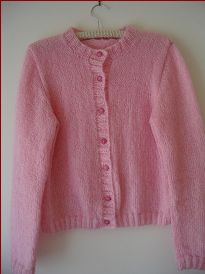 Knitting pattern for a ladies classic cardigan, in plus sizes.