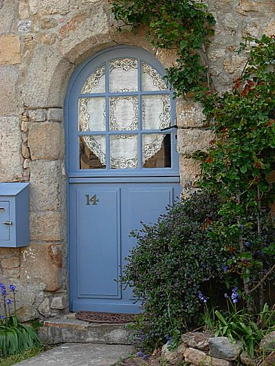 blue door of a stone cottage