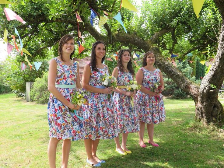 Floral bridesmaids, contrasting accessories, dresses by mokka5oclock etsy and flowers by one flew over.