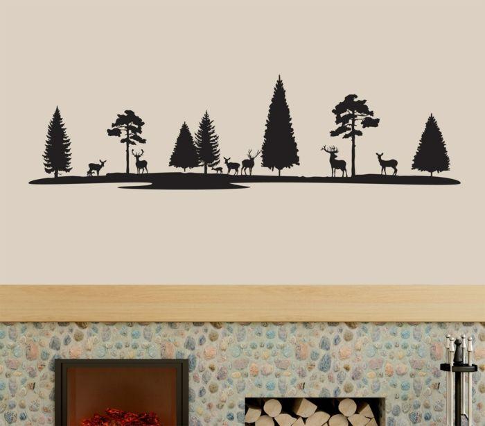 pegatinas pared, salón con chimenea de piedra, vinilo negro, bosque con pinos y ciervos, pared beige