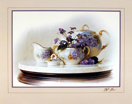 A must have in your home kitchen wall. This poster depicts the image of violets flowers print tea pot which will surely impress you every time when you enter in your kitchen. This Tea Pot Still Life Fine art print poster will would make a dramatic statement in any kitchen and will be a great gift for the Tea Pot collector. Easy to use and maintain and ensures high quality with a perfect color accuracy.