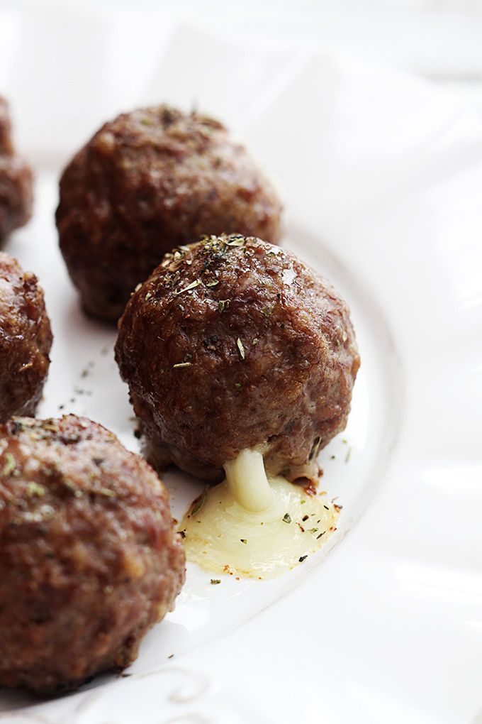 Juicy, flavorful Italian style meatballs stuffed with melty mozzarella cheese - perfect for dipping in your favorite red pasta sauce or alfredo sauce!