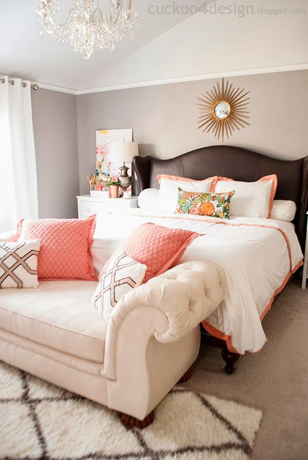 Loving this neutral bedroom, made fun with touches of coral throughout the  space, from