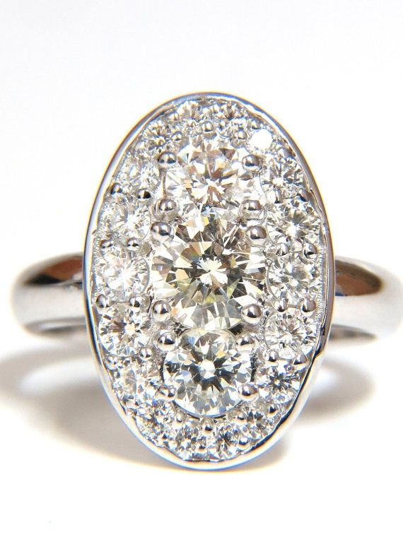 1.96ct. Natural round diamonds elongated cluster ring.    Rounds & Full cut Brilliants Center Diamond: .60ct.     Si-1 clarity.    J-color.      All