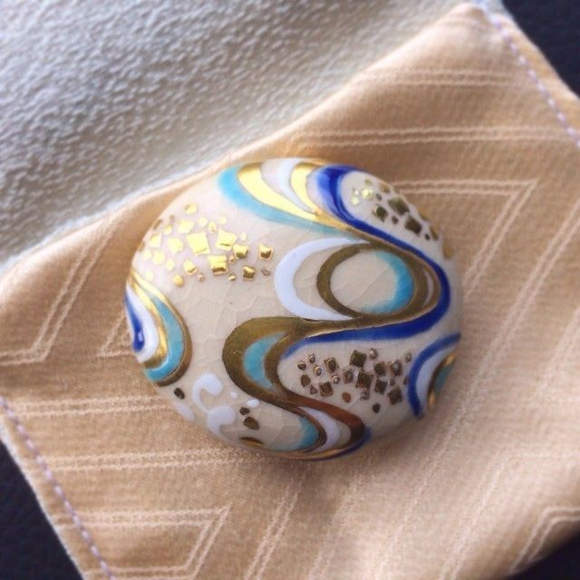 Obi-dome: small brooches worn threaded onto the obijime, making a charming decoration on the front of the obi