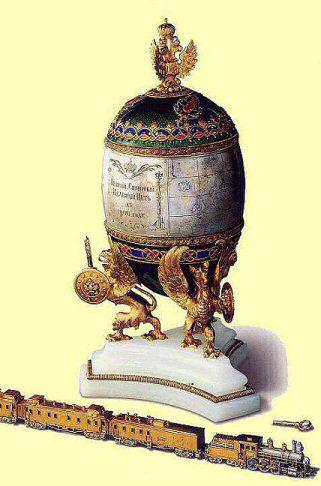 Trans-Siberian Railway Egg, 1900. Presented by Nicholas II to Czarina Alexandra Fyodorovna. Platinum, tinted gold, silver, diamonds, rubies, onyx, rock crystal, wood, silk, velvet. Kept in Kremlin Armoury Museum, Moscow.