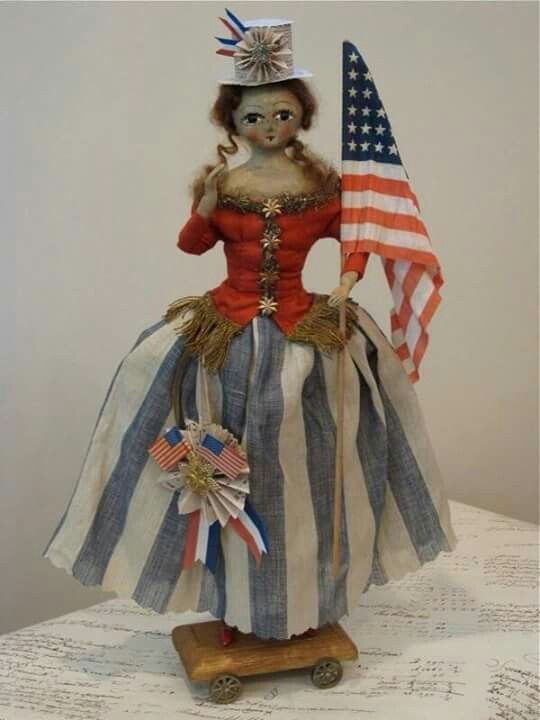 Boneca com roupas e bandeira  Americana.