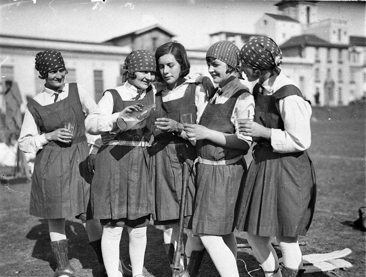 Five schoolgirl hockey players enjoy a glass of lemonade, Sydney University. Jun 1929. Find more detailed information about this photograph: http://acmssearch.sl.nsw.gov.au/search/itemDetailPaged.cgi?itemID=10356  Digital order no. hood_05956 From the collection of the State Library of New South Wales: http://www.sl.nsw.gov.au