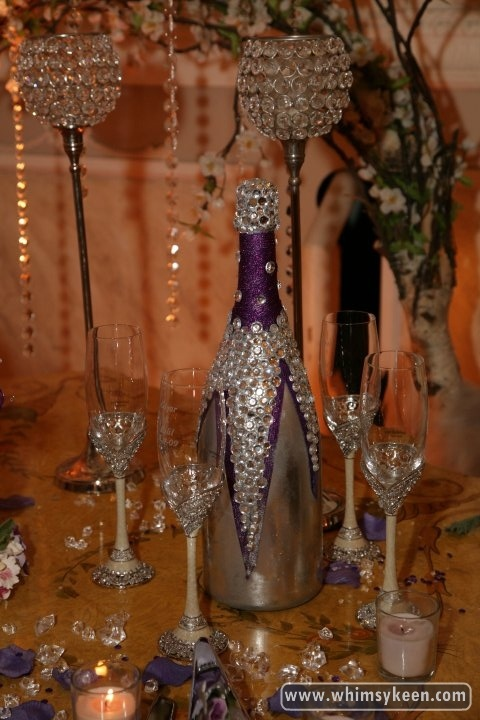 Custom-decorated champagne bottle for engagement party.