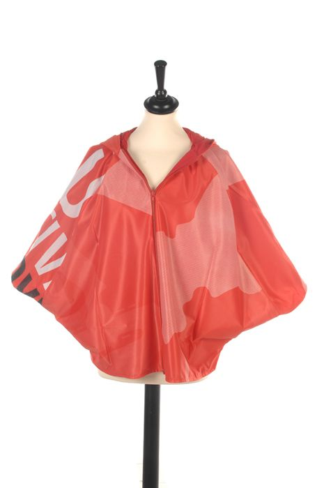 Contemporary style for adults. Outside bannermaterial from music festival with cotton lining and zipper in front.