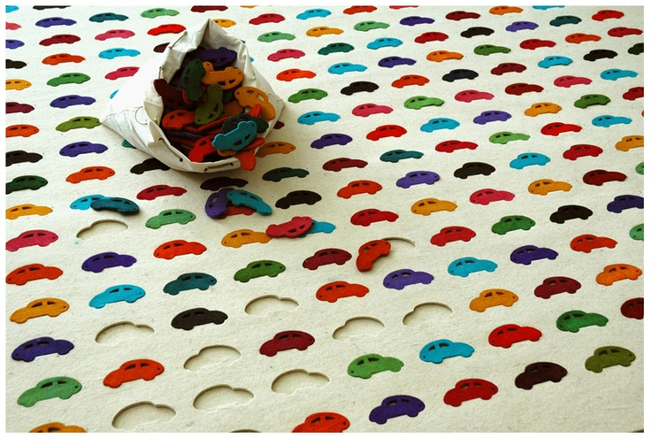 Carpet is made up of multi-coloured cut-outs in the shape of cars that can be pulled out and repositioned, changing the layout of the rug | Agnieszka Czop and Joanna Rusin