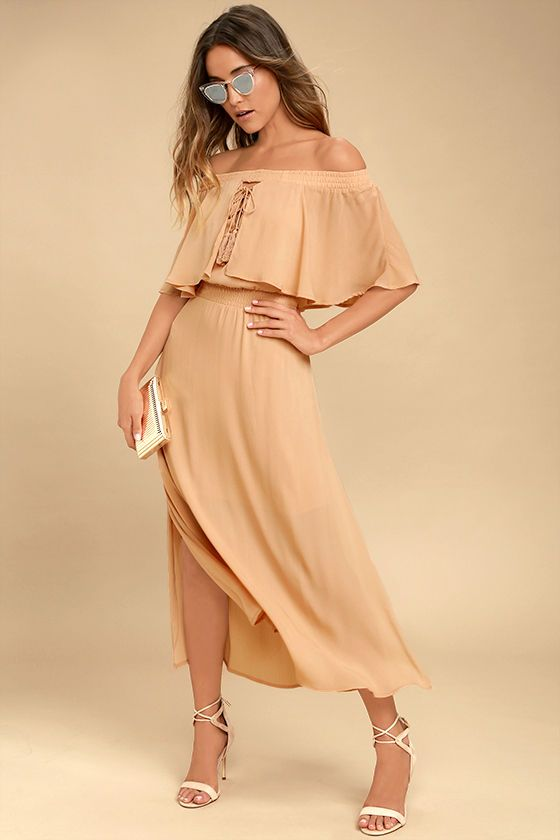 The Somedays Lovin' Touch the Sun Nude Off-the-Shoulder Midi Dress is your secret weapon for sunny days! Gauzy woven poly, in a nude-meets-peach hue, falls from a elasticized off-the-shoulder neckline into a fluttering flounce and lace-up bodice. Smocked waist tops a breezy midi skirt with side slits.