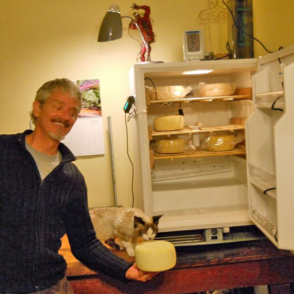 Jon with his cat, Koba This takes your dorm sized refrigerator to a whole new level! As you may know, we sell a refrigerator thermostat which enables you to convert your refrigerator or freezer into a cave by regulating the temperature.  This solves the temperature issue.  And, for most purposes, you can add enough humidity by simply keeping a wet towel in your cave.