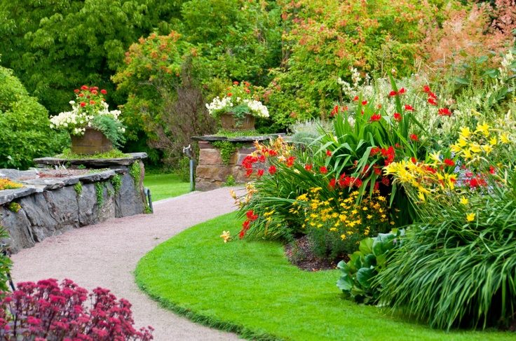 Small, curvaceous lawn and magnificent garden. #small #lawn #mower