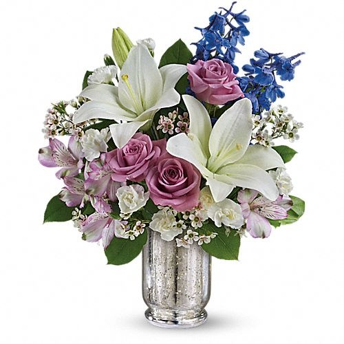 Garden Of Dreams Bouquet - Send Fresh Flowers Internationally   Make her dreams come true with this ethereal bouquet, presented in a stunning Mercury Glass hurricane. Beautiful snow-white lilies, lavender roses and a bright blue hint of delphinium create a dreamy declaration of your affection she'll never forget.