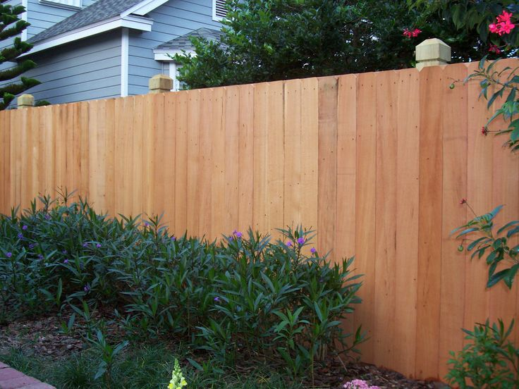Wood privacy fence with dado posts | Mossy Oak Fence Company, Orlando & Melbourne, FL