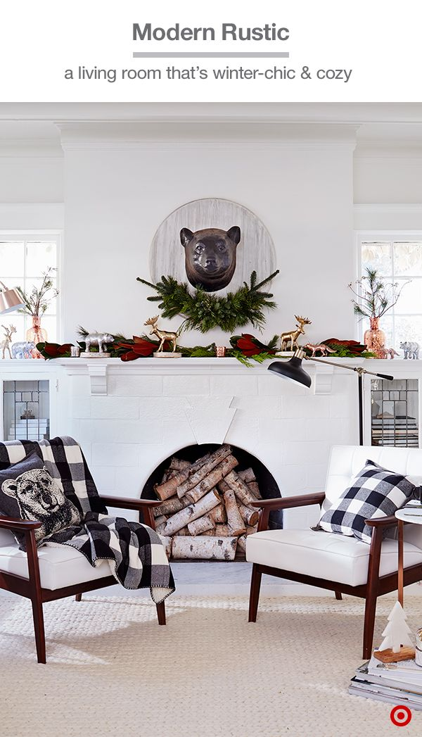 Sometimes all you need are a few accents to turn an all-white room into a rustic-meets-modern holiday haven. Pair a graphic bear pillow with a buffalo-check pillow and throw, add fragrant greens (like pine, eucalyptus or magnolia leaves) to the mantle, and hang a very cool faux-bear head above the fireplace. Balance the whole look with on-trend copper mercury-glass jugs on each side and pop in some metallic, animal figurines for hints of glam. Love it? Shop our Nordic Winter collection.