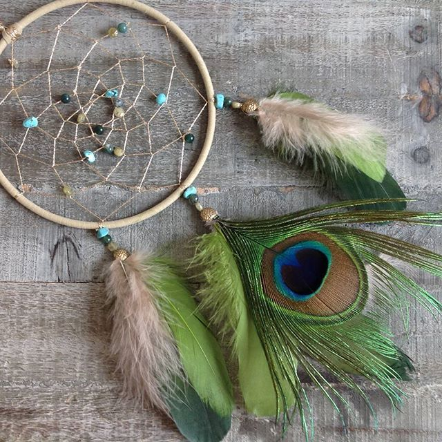 One of my favorites.  Made with peacock feathers and real stones like tourquise and achat! #traumfänger #dream #dreamcatcher #chatchyourdream #catchyourdreams #selfmade #handmade #feathr #feathers #stones #realstones #nofilter #federn #handgefertigt #steine #türkis #moosachat #peacock #peacockfeathers #pfau #pfauenfeder