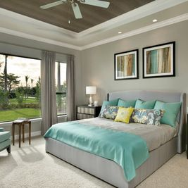 Example of Anew Gray by SW in a master bedroom. Seems to go well with turquoise and yellow.