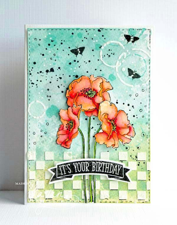 Poppies | Background with Distress Oxide, stencils, stamps and structure paste. The poppies stained with Zig real Brushes and cut out. The sentiment is from a set of Clearly besotted, like the mini butterflies.