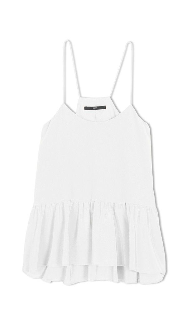 Silk crepe de chine camisole with ruffle peplum detail. Partially lined. Fabrication: 100% Silk. Dry Clean Only. White Silk Strappy Ruffle Cami styled with Ibis Easy Track Pant and Mina Sandal. Style number: T0000SHS73279