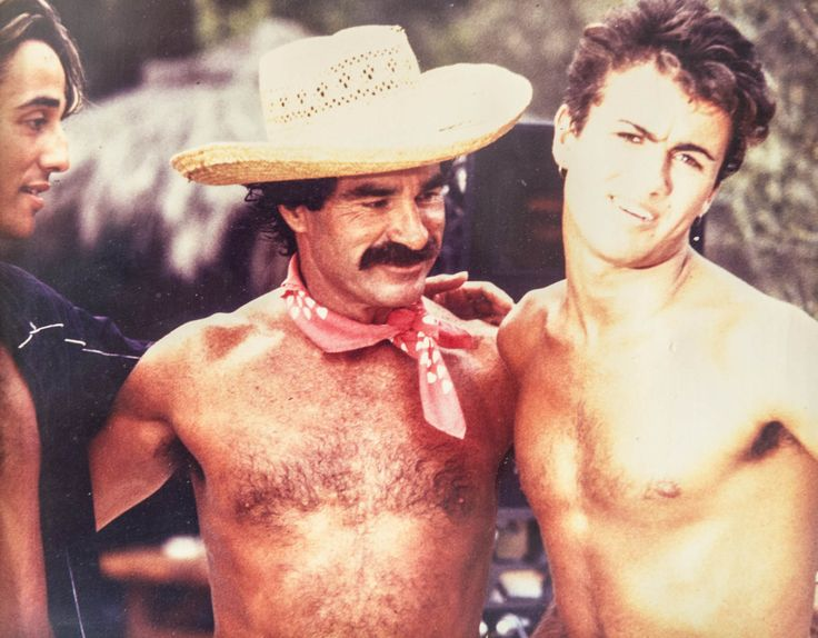 Andrew Ridgeley, Anthony Pike and George Michael taking a break while filming Wham!'s Club Tropicana video at the pool of the Pikes Hotel in Ibiza