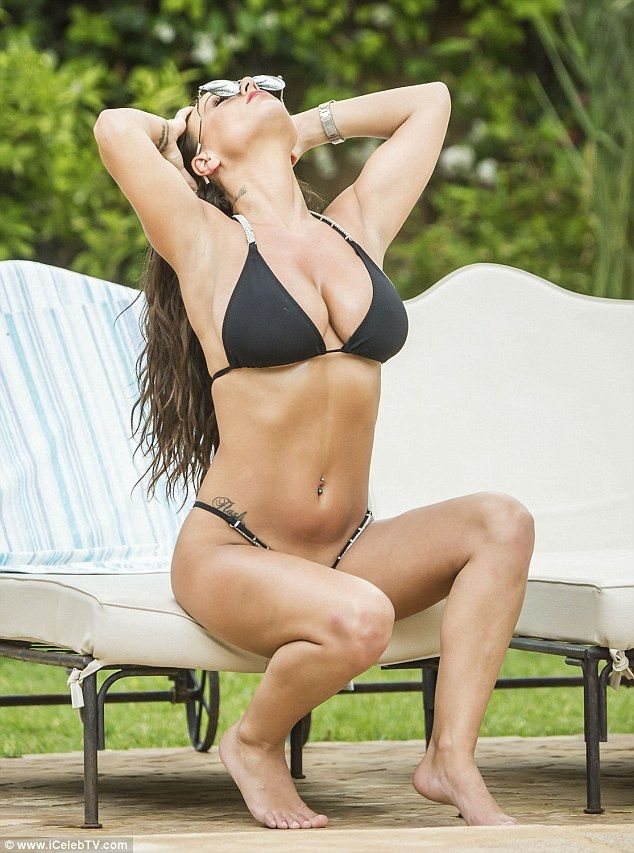 Busty:Posing on a chair by the pool, she revealed her shapely, smooth legs, taut tum and ...