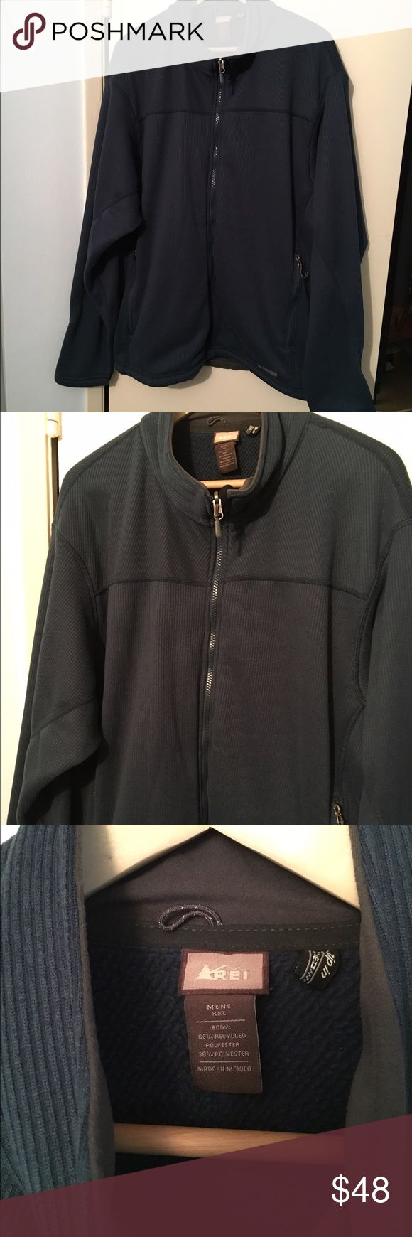REI Men's Fleece Jacket XXL Classic blue men's fleece jacket from REI. In new condition (no tag) it has zippered pockets and a drawstring at the waist. REI Jackets & Coats