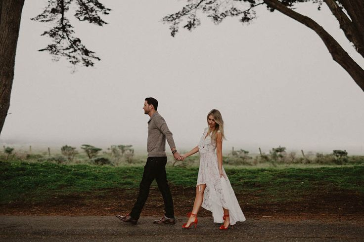 This stylish Point Reyes engagement session has super sultry details like moody lighting, bright red pops of color, and of course, a passionate couple!