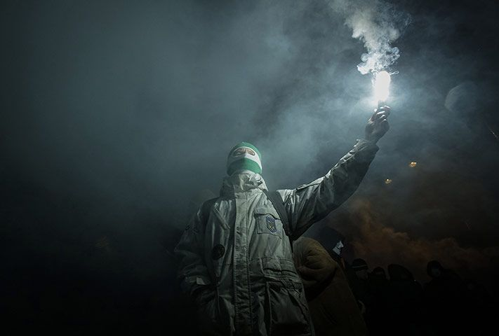 Credit: Reuters An activist participates in a rally to mark the 105th year since the birth of Stepan Bandera, one of the founders of the Org...