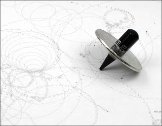Use a washer and a pencil stub to create fun spin drawings - like a top!