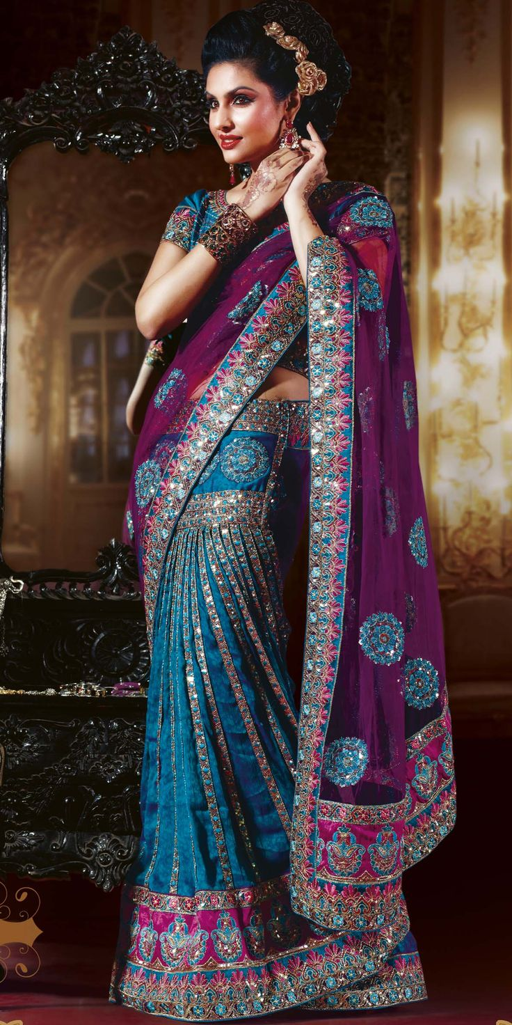 Awesome combination of teal blue and purple color lehenga saree on self printed crepe skirt part and net pallu having glowing work patch border, sami stitch choli, exclusive work contrast patch on lower skirt part and pallu bottom and magical work of sparkling sequins, jari, resham embroidery and fancy lace work. (Lalit Khatri | Item code: SAB923B | www.lalitkhatri.com)