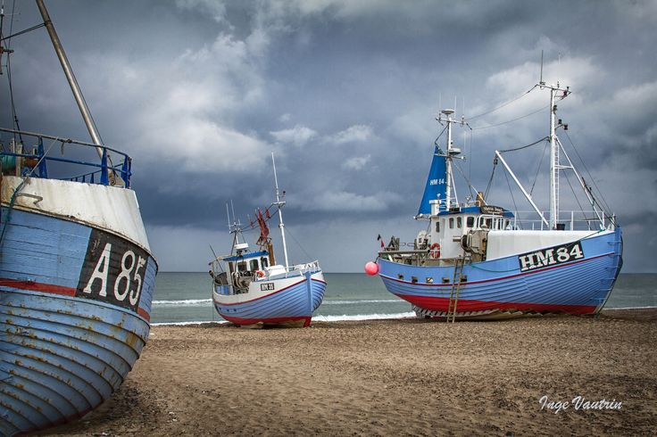 Thorup Strand, North Sea, Jutland, Denmark. - There is no harbor here so the fishing boats are being pulled up on the beach.