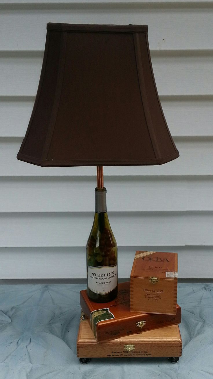 Wine bottle and cigar box lamp. Wine bottle is filled with fake multi colored grapes..!!