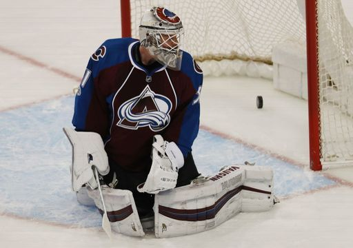 Colorado Avalanche goalie Calvin Pickard looks back to see the puck drop in the net for a goal off the stick of Carolina Hurricanes defenseman Justin Faulk in the first period of an NHL hockey game, Tuesday, March 7, 2017, in Denver. (AP Photo/David Zalubowski)