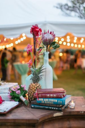 Tropical decor & twinkling string lights: http://www.stylemepretty.com/destination-weddings/2015/08/26/tropical-colorful-wedding-in-kauai-botanical-garden/ | Photography: Heather Cook Elliott - http://heathercookelliott.com/