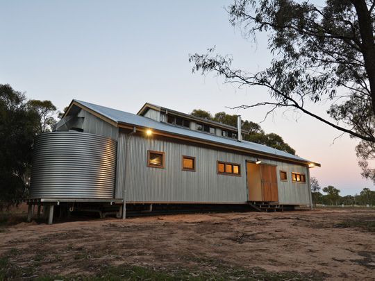 Matty - I live this modern AUST farmhouse with the water tank clearly visible and traditional galvanised iron used in a modern way